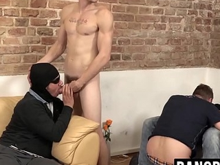 Massive cock gets sucked on in the middle of a steamy orgy